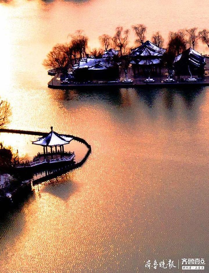 明湖夕照,残雪映春!骤然而至的春雪让泉城更添魅力